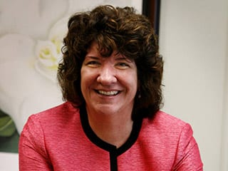 Mercer County Special Services School District Superintendent Dr. Kimberly J. Schneider smiles in a close-up photograph.