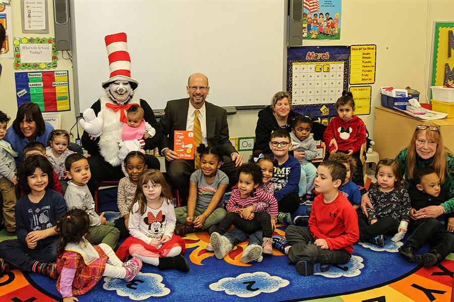 Bergen County Special Services School District Superintendent Dr. Howard Lerner and a Cat in the Hat impersonator pose with a large group of students from the district's Bergen Early Learning Alliance Day Care and Integrated Preschool.