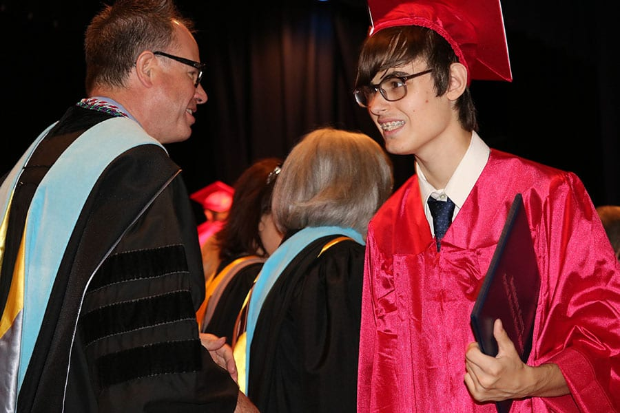 Burlington County Special Services School District Superintendent Dr. Christopher Nagy shakes hand with a student at the district's graduation ceremony.