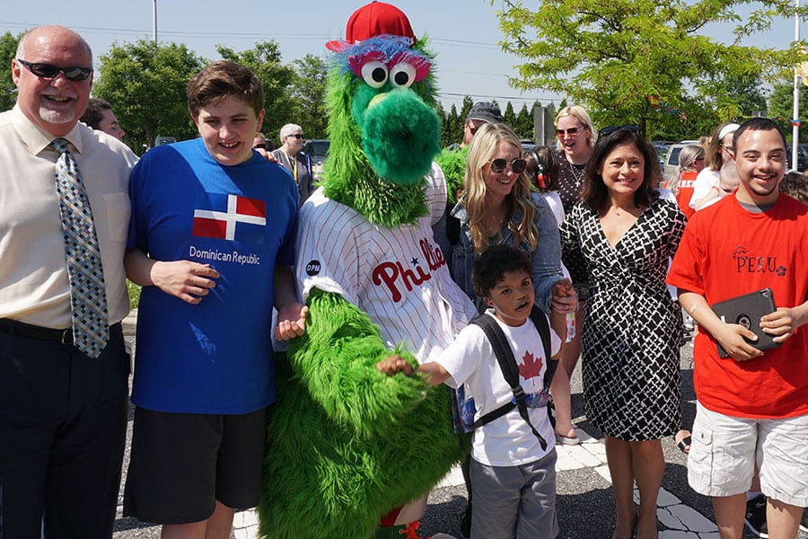 Bankbridge Development Center hosts Olympic Week for the students in conjunction with the Special Olympics, and Gloucester County Special Services School District Superintendent Mike Dicken poses with students, staff, the Phillie Phanatic and Gloucester County Freeholder Heather Simmons at the opening ceremony.