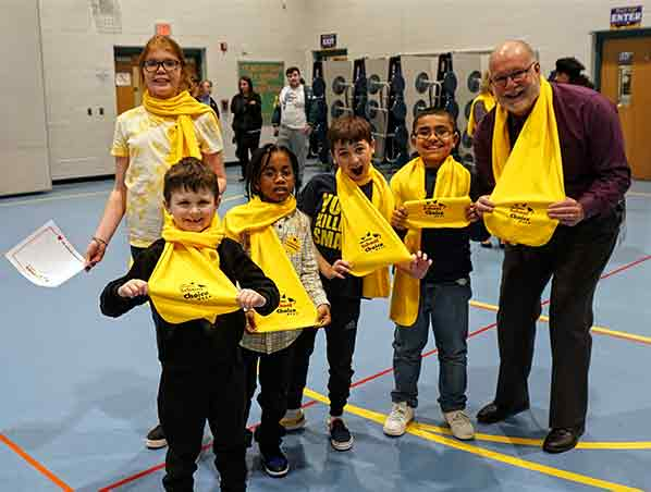 A small group of Bankbridge Elementary School students pose with Gloucester County Special Services School District Superintendent Mike Dicken wearing yellow scarfs for National School Choice Week.