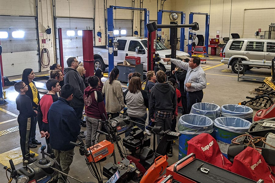 Students with Autism or Social Communication Disorders from the Upper Pittsgrove program run by Salem County Special Services School District tour the Salem County Vocational School's automotive area with Superintendent Jack Swain to learn more about the CTE programs at the high school level.
