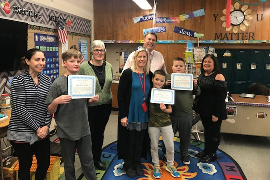 Salem County Special Services School District hosts a Student of the Month breakfast with all winners posing alongside Superintendent Jack Swain and staff, who presented the students with certificates that the students are now holding up.