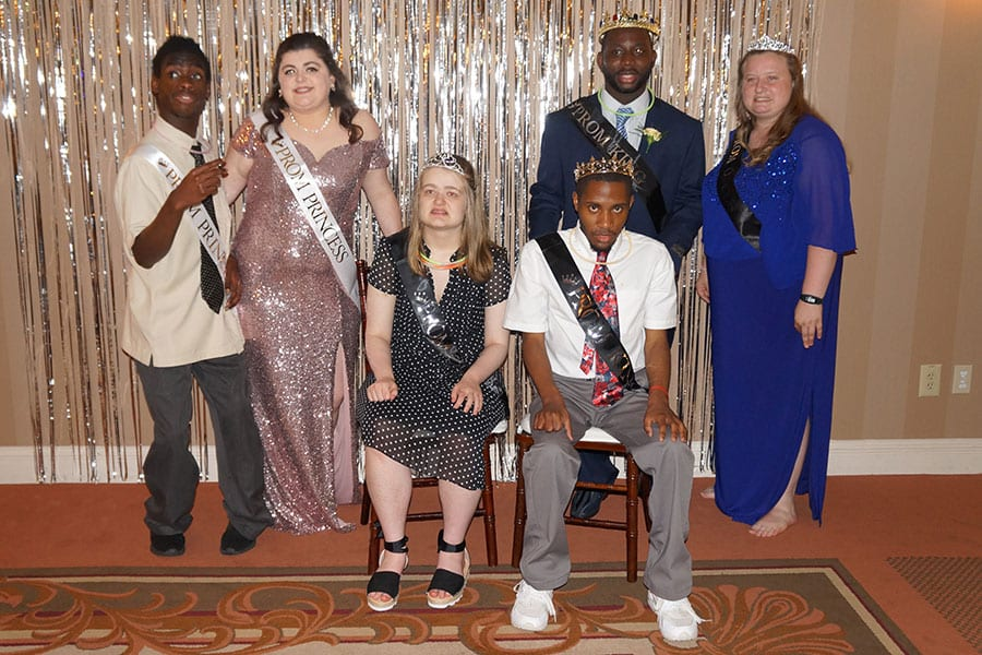 A small group of Salem County Special County Services School District students pose for a prom photo at Centerton Country Club.