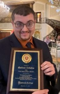 Andrew S., a graduate of Bergen County Special Services School District's Transition Program, poses and smiles with his Top Employee Award from Eastwick College