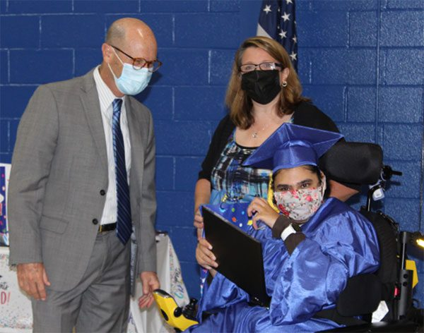 Dr. Howard Lerner, Superintendent of Bergen County Special Services School District is seen with a student, who had just received their diploma.